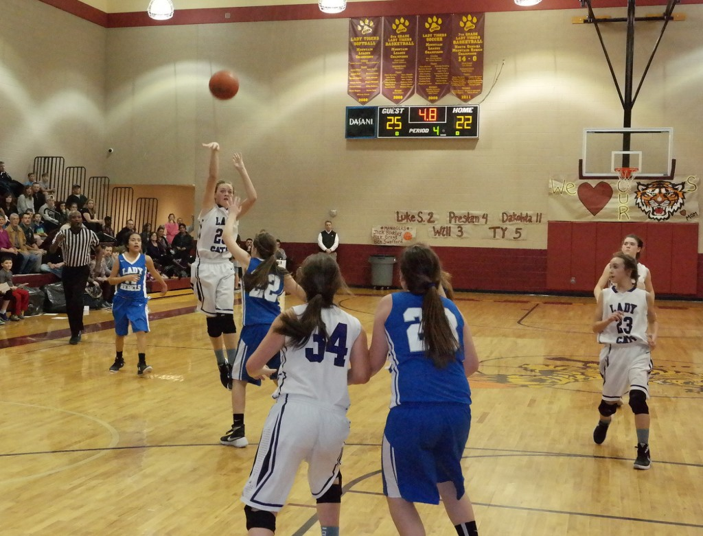 Seventh-grade Lady Cat Emma Callihan shoots the game-tying three-point shot against Fannin last night. The basket sent the game into overtime, where Clear Creek bested the Lady Rebels 32-31 to win the 2015-16 North Georgia Mountain League seventh-grade girls championship. (Photo by: Kevin Hensley)