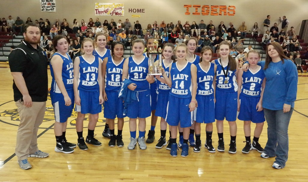 The seventh-grade Fannin County Middle School Lady Rebels pose with the 2015-16 North Georgia Mountain League runner-up trophy. (Photo by: Kevin Hensley)