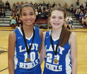 After the Clear Creek/Fannin game, the Lady Rebels recognized Kennedy Harper (left) as their Academic Award recipient and Abby Ledford (right) as their All-Tournament selection. (Photo by: Kevin Hensley)