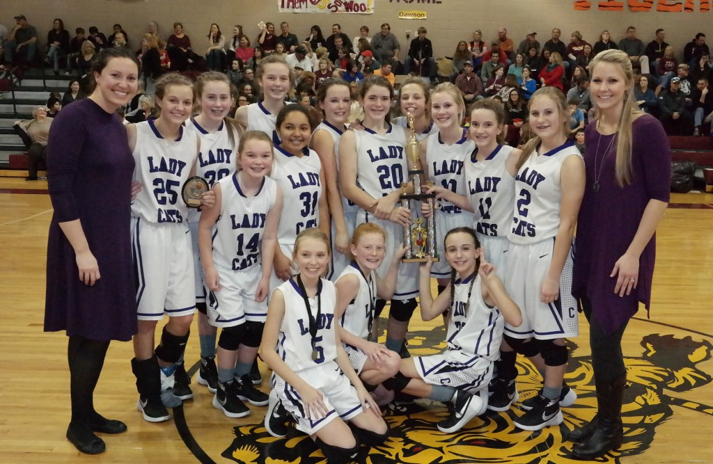 The seventh-grade Clear Creek Middle School Lady Cats pose with the 2015-16 North Georgia Mountain League championship trophy. (Photo by: Kevin Hensley)