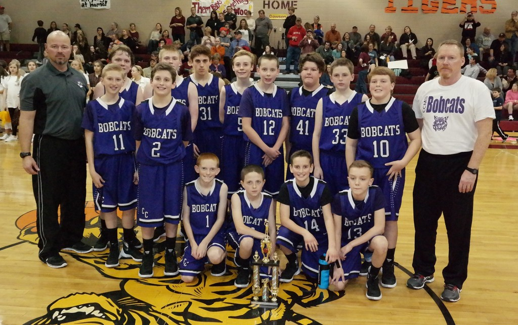 The seventh-grade Clear Creek Middle School Bobcats pose with the 2015-16 North Georgia Mountain League runner-up trophy. (Photo by: Kevin Hensley)