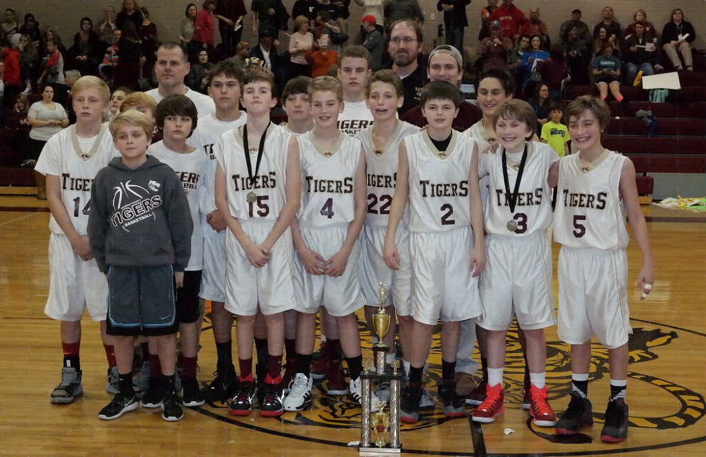 The seventh-grade Dawson County Middle School Tigers pose with the 2015-16 North Georgia Mountain League championship trophy. (Photo by: Kevin Hensley)