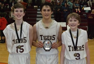 After the Dawson/Clear Creek game, the Tigers recognized Luke Hamby (left) as their Academic Award recipient, Dakota Sonnidson (center) as their Tournament MVP and Will Howard (right) as their All-Tournament selection. (Photo by: Kevin Hensley)