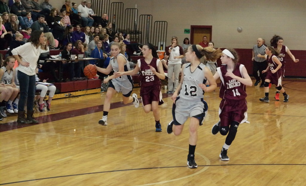 Riverview coach Natasha Beary watches as Lady Eagle Chloe Bennett attempts to drive past Rachel Swafford in last night's 2015-16 North Georgia Mountain League eighth-grade girls championship game. Bennett scored a team-leading eight points in the Lady Eagles 31-24 victory over the Lady Tigers. (Photo by: Kevin Hensley)