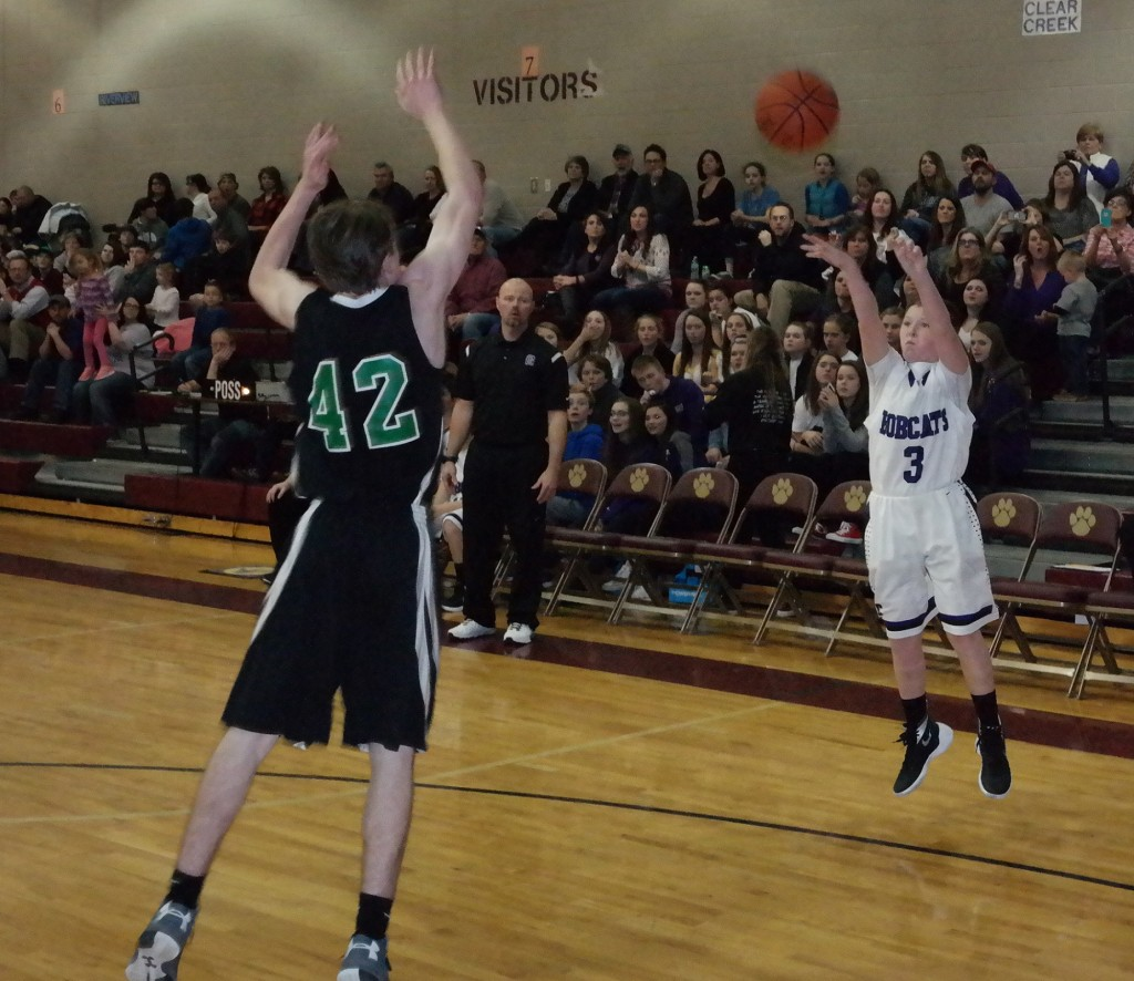 Eighth-grade Bobcat Luke Wimpey shoots a three-point shot in last night's 2015-16 North Georgia Mountain League eighth-grade boys title game. Wimpey scored six points in Clear Creek's 35-24 championship victory over the Pickens Dragons. (Photo by: Kevin Hensley)