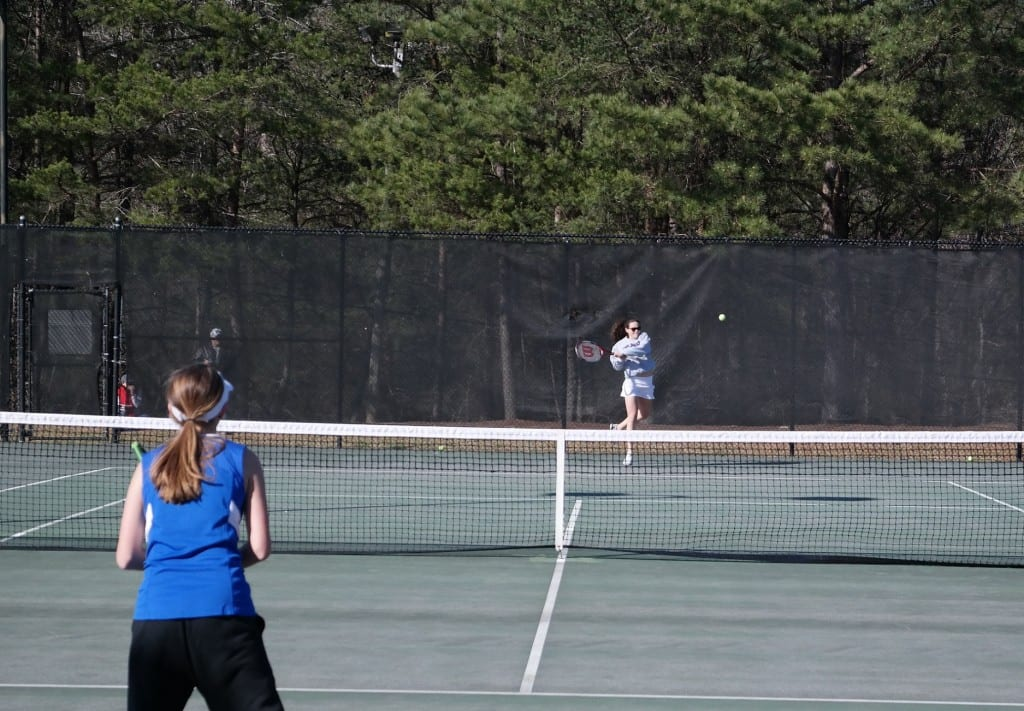 Lady Cat Kali Malham returns a shot during a match against Fannin March 22. Malham won two of her three matches for Gilmer this week. (Photo by: Kevin Hensley)